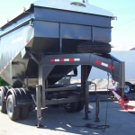 Gooseneck Surge with Ease Guide Coupler on Grain Cart Trailer